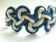 bracciale bicolore con nodi cinesi