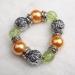 Bracciale con grandi perle colorate