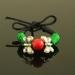 Bracciale con nodi cinesi e perline