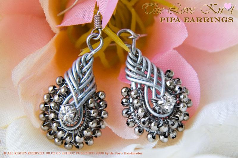 Orecchini con nodi cinesi in argento e cristalli